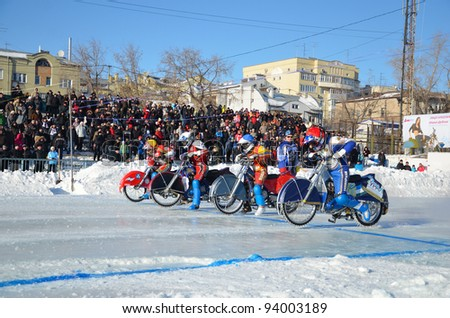 SAMARA, RUSSIA - JANUARY 29: Start of the race unidentified motorcycles with spikes on the motorcycle races ice the Cup of Russia January 29, 2012 in Samara, Russia