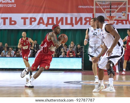 SAMARA, RUSSIA - NOVEMBER 02: Chalmers Lionel of BC Lokomotiv-Kuban, with ball, is on the attack during a BC Krasnye Krylia game on November 02, 2011 in Samara, Russia. - stock photo