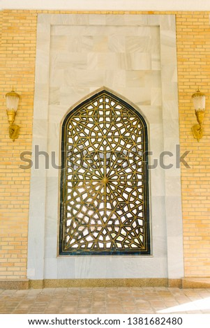 Samarkand, Uzbekistan. April 2019. Eastern patterned lattice on the window #1381682480