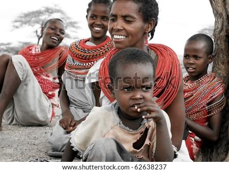 SAMBURU,KENYA-NOVEMBER 8:Samburu  woman with her children all smiling,portrait of an African family,review of daily life of local people,near Samburu Park National Reserve on Nov 8, 2008 in Kenya