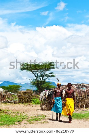 SAMBURU, KENYA - NOVEMBER 8: unidentified African tribal men, walking in the village on November 8, 2008 in tribal village near Samburu National Park Reserve, Kenya