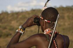 Samburu Masai  guide with rifle  look horizon with binoculars