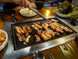 Samgyeopsal, grilled pork belly popular in South Korea. Three layer flesh referring to striations of lean meat and fat in the pork belly. Favorite Korean food. K-food. Korean barbecue. Korean BBQ.