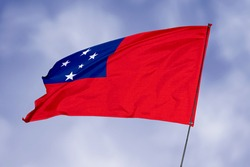 Samoa flag isolated on sky background. National symbol of Samoa. Close up waving flag with clipping path.