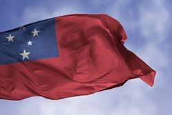 Samoa flag isolated on the blue sky with clipping path. close up waving flag of Samoa. flag symbols of Samoan.