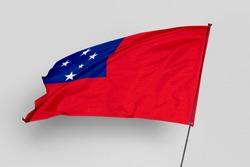 Samoa flag isolated on white background. National symbol of Samoa. Close up waving flag with clipping path.