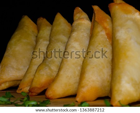 Samoosas, also sometimes referred to as a somosa, are an ever popular Indian delicacy in Durban, South Africa. Durban has the largest Indian polulation of any Western city in the world. #1363887212