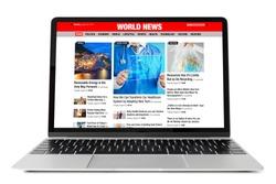 Sample news website shown on laptop computer