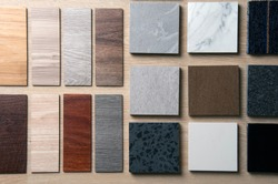 Sample of materials construction on wood background. Materials use for Interio designer. Home construction decorate room with luxury constructions set. Sample of Concretes and Wood laminate vinyl.