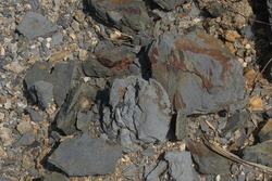 Sample of natural shale sedimentary rock. Shale is a fine-grained sedimentary rock that forms from the compaction of silt and clay-size mineral particles that we commonly call mud.