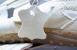 Sample of white genuine leather on summer shoes