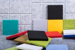 Samples of acoustic panels in red, green, black, yellow and blue colors
