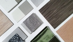 samples of interior material consists concrete tile, wooden laminated or veneer, artificial stones, green fabric for drapery, wooden vinyl flooring. interior selected material for mood and tone board.