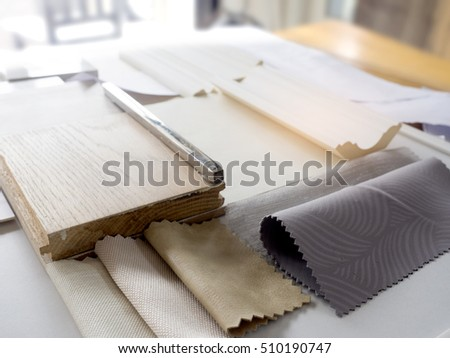Samples of material, wood , color , fabric  , on wooden table.Interior design select material for idea.
