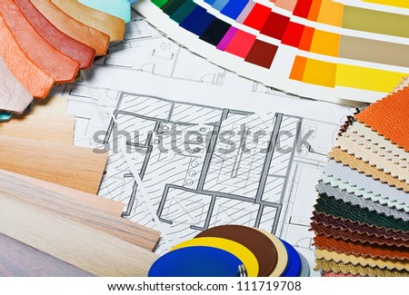 samples of materials colors, upholstery and cover the architectural drawing