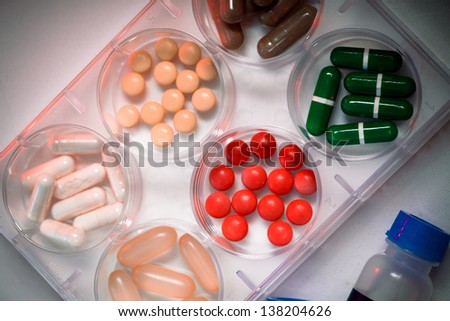 Samples of medicines tablets capsules vitamins and placebo