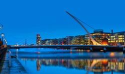 Samuel Backett Bridge (Harp Bridge) at twilight blue hour - River Liffey, Dublin  Ireland