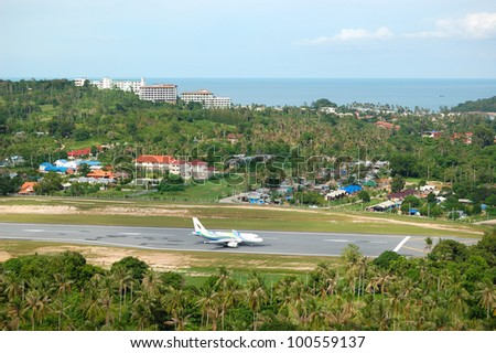 SAMUI, THAILAND - SEPTEMBER 10: The aircraft of Bangkok Airlines landing at Samui Airport on September 10, 2010 in Samui, Thailand. Flights to Samui island by Bangkok Air were established in year 2010