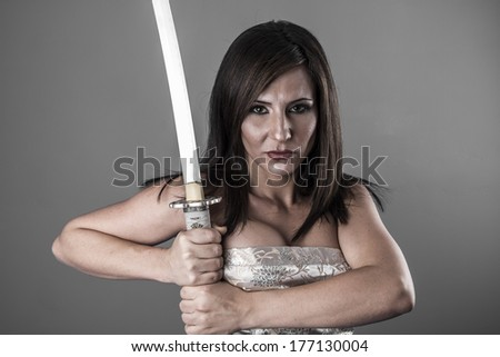 Stock Photo Samurai.Anime stylized brunette with short hair holding a katana sword with two hands
