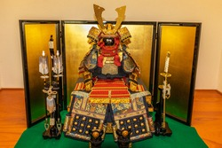 Samurai doll wearing armor and helmet on the alcove in Japanese room