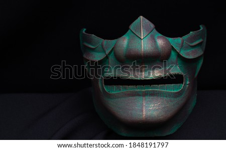 samurai mask with a black background