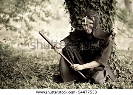 Samurai sitting under the tree