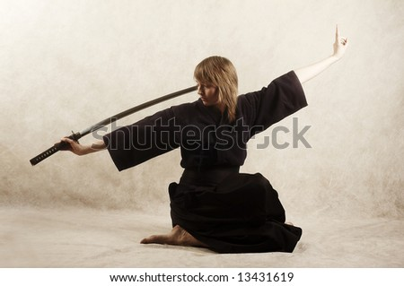 samurai with blade sits