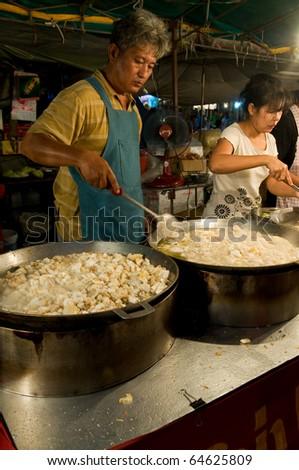 SAMUT PRAKAN - NOVEMBER 7: Man sells soup in an improvised restaurant at Pra Samut Chedi temple fair on November 7, 2010 in Samut Prakan, Thailand.