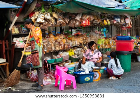 Samutsakorn Province, Thailand - March 14, 2019: Daily life of street vendors selling variety of nuts, spices, and herbs on the main street market. #1350953831