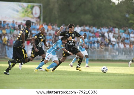 SAMUTSONGKHRAM  THAILAND- JUN 12 : V.Carvalho (R) in action during Thai Premier League (TPL) between Samutsongkhram Fc (Blue) vs Army Utd (Black) on Jun 12, 2011 at Samutsongkhram, Thailand