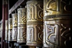 SAMYE, TIBET, CHINA - AUGUST, 16 2018: Tibetan prayer wheels at the Monastery of Samye, Tibet Autonomous Region, China - Asia