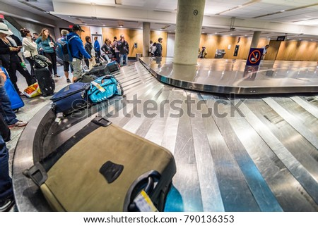 SAN ANDRES ISLAND, Colombia _ March 30th, 2017. Arrival of the Luggages in the Montreal Airport Convoyer at Night Ready to Pick-up