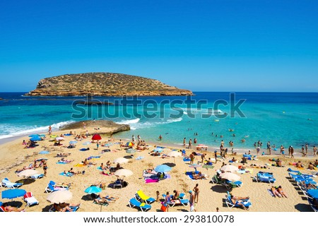 SAN ANTONIO, SPAIN - JUNE 15: Sunbathers at Cala Conta beach on June 15, 2015, in San Antonio, in Ibiza Island, Spain. Ibiza is a well-known summer tourist destination in Europe