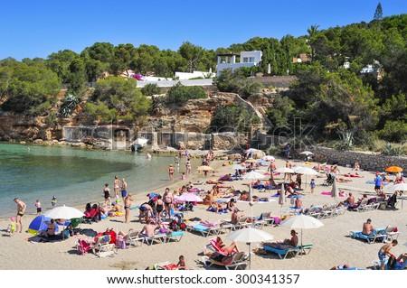 SAN ANTONIO, SPAIN - JUNE 18: Sunbathers at Cala Gracio beach on June 18, 2015, in San Antonio, in Ibiza Island, Spain. Ibiza is a well-known summer tourist destination in Europe