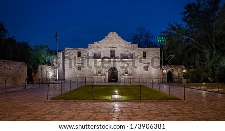 SAN ANTONIO, TEXAS - JANUARY 7: The Alamo, originally known as Mission San Antonio de Valero, with the Crockett Hotel neon sign in the background on January 7, 2014 in San Antonio, Texas
