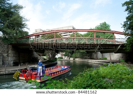 SAN ANTONIO, TX - AUG 12: A River Taxi at the River Walk in San Antonio, Texas on August 12, 2011.  The River Walk is 5 miles along the San Antonio River with over 20 yearly events.