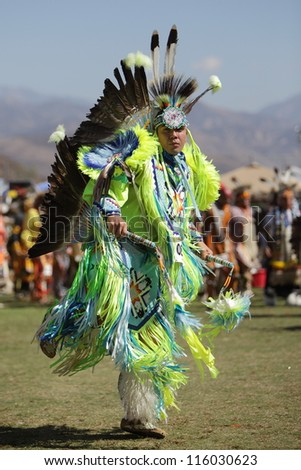 SAN BERNARDINO, CALIFORNIA - OCTOBER 13: The San Manuel Band of Indians hold their annual Pow Wow on October 13, 2012 in San Bernardino. A tribal warrior performs the Fancy Dance.