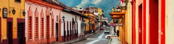 San Cristobal, Mexico. Streets in the cultural capital of Chiapas - San Cristobal de las Casas, Mexico. Spanish colonial layout and architecture. Mountains at the background