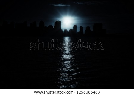 San Diego blue cool urban skyline in monochrome black and white with beautiful contours of down town cityscape with burning sun reflecting in sea water. More similar content is found in my portfolio.  #1256086483