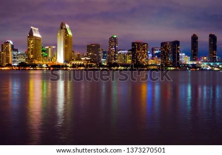 San Diego, CA / USA - April 15, 2019: Colorful reflections  San Diego Downtown skyline from Coronado pier #1373270501