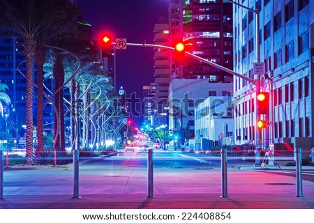 San Diego City Center Intersection at Night. Red Lights Traffic Lights. San Diego, California, USA.