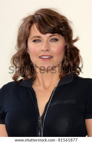 SAN DIEGO - JUL 22:  Lucy Lawless at the 2011 Comic-Con Convention - Day 2 at San Diego Convention Center on July 22, 2010 in San Diego, CA.