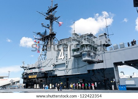 SAN DIEGO, USA - APRIL 9: Deck and  tower  of the Aircraft carrier Midway as a museum of US navy at the Broadway Pie of San Diego, California, USA on April 9, 2011.