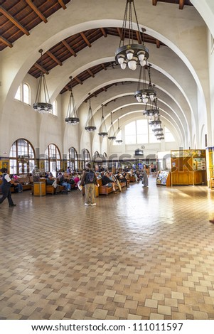 SAN DIEGO, USA - JUNE 11: people wait for the trains inside Union Station on June 11, 2012 in San Diego, USA. The Spanish Colonial Revival style station opened on March 8, 1915 as Santa Fe Depot.