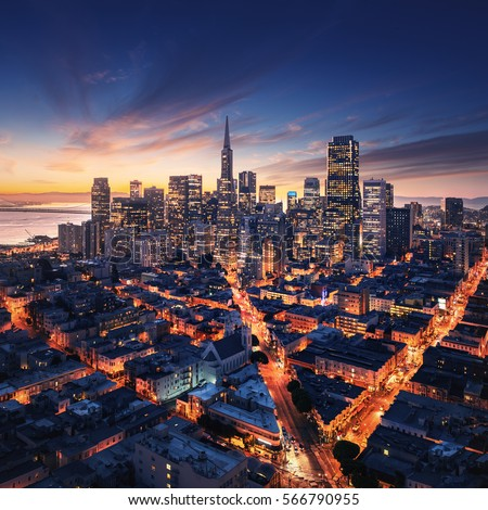 San Francisco aerial view from sea side. Port of San Francisco in the front. City downtown and skyscrapers at sunrise. #566790955