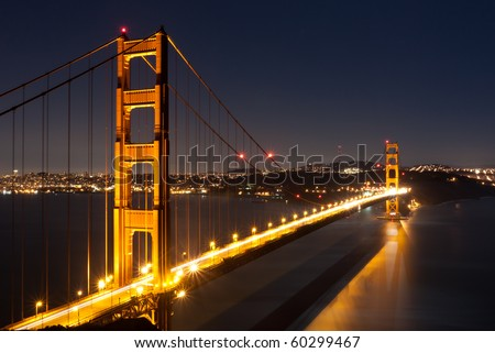 San Francisco and The Golden Gate Bridge under a Beautiful Full Moon Evening