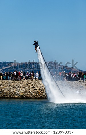 SAN FRANCISCO - AUGUST 25: Jet propelled man launches during Louis Vuitton Cup in The Americas Cup Series on August 25, 2012 in San Francisco Bay, where cup finals will be held summer 2013.