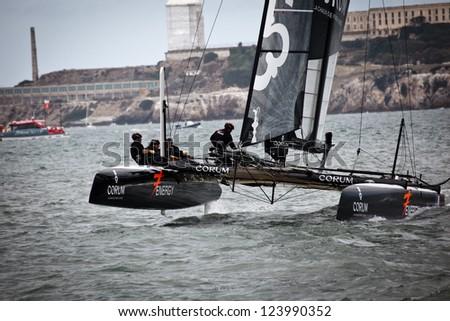 SAN FRANCISCO - AUGUST 25: Team Corum speeds by Alcatraz Island in Louis Vuitton race in Americas Cup Series 2012 on August 25, 2012 in San Francisco, where cup finals will be held summer 2013.
