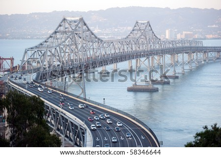 san francisco bay bridge with the city of oakland in the background