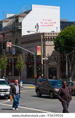 SAN FRANCISCO, CA - CIRCA MAY 2010: Stencil graffiti piece by Banksy on a building on a corner of Columbus St and Broadway St, circa May 2010 in San Francisco, CA